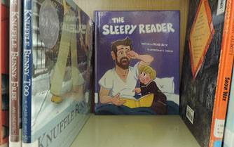 Beck's first book, The Sleepy Reader, sits on the children book shelf in the North library. Beck's book was published Sept. 4, 2018.