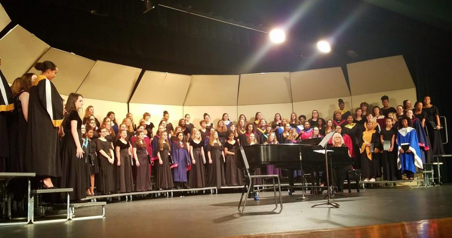 Select+choir+members+from+different+school+districts+come+together+to+perform+at+the+All+Suburban+Choir+Concert.+The+audition+proved+to+be+anxious+for+many.+
