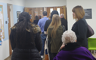 Voters stand in line to vote at Mt. Zion United Methodist Church. Voters there said lines were longer than expected that afternoon but moved fairly quickly.