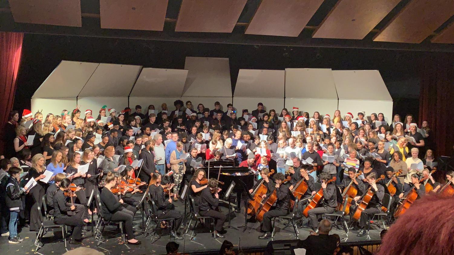 "Performing together, the combined choirs, the symphonic orchestra, and members of the audience play ""Hallelujah!"" at the Parkway North Winter Choir Concert on Dec. 12, 2018."