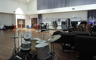 Although band students may occasionally occupy the practice room for special circumstances, the room sits empty during ac lab most of the time because there are no staff members available to monitor the room.