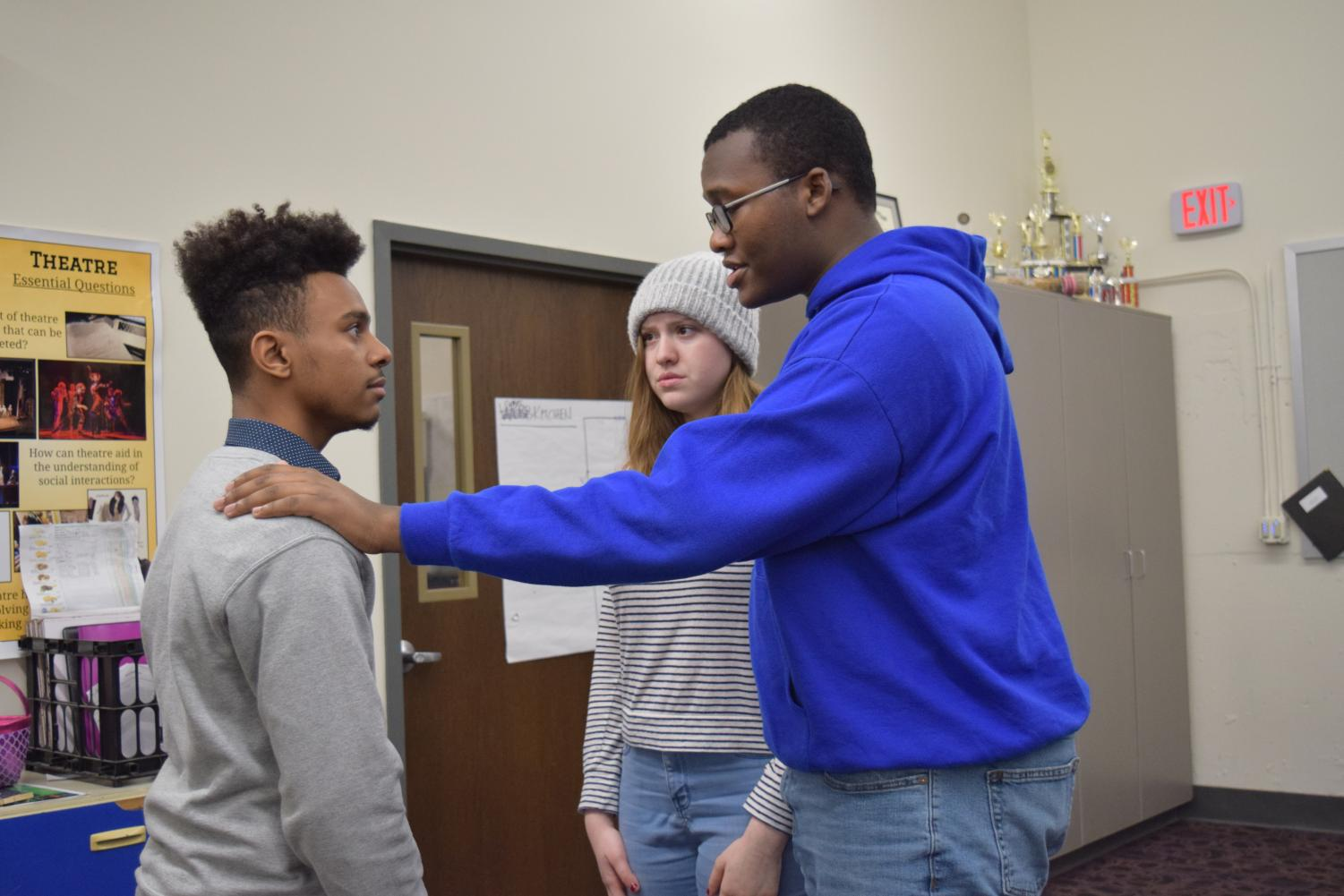 "Juniors Cassie Schoene, Javon Spearman, and Rome Little rehearse together after school. ""Come see the show, because I really feel like this is a little different from something that we'd usually do… I think it's going to be a really good show,"" said Schoene."