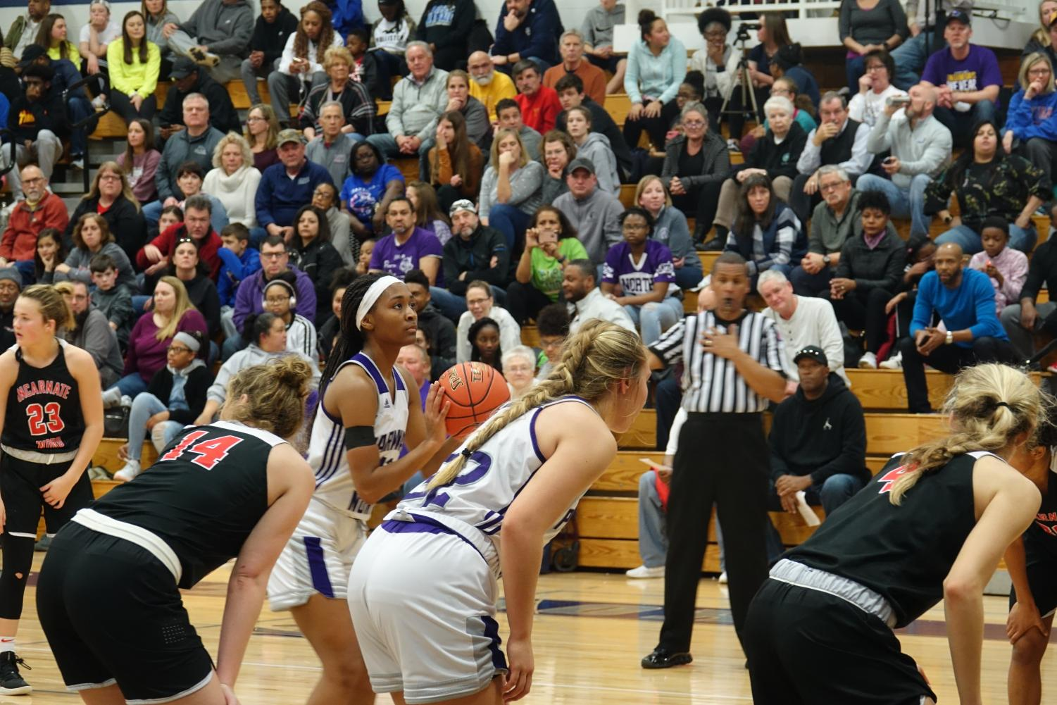 """In the fourth quarter, Davis gears up to make a free throw after a foul by the Red Knights. """"[It was a great how we] came back in the fourth quarter after being down by so much,"""" said Rhodes."""