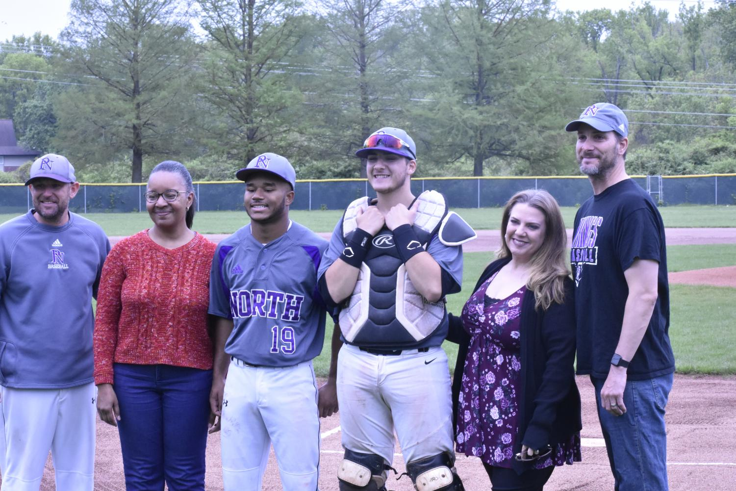 """Seniors Lucian Thibodeaux and Jacob Sigler were escorted by their parents and teamed up with varsity coach, coach Mark Reeder during senior night for varsity baseball on May 3, 2019 at 4:15 p.m. at North's home field. """"Senior season was really good; it was nice to know my teammates and coaches have high expectations of me,"""" said senior Lucian Thibodeaux."""