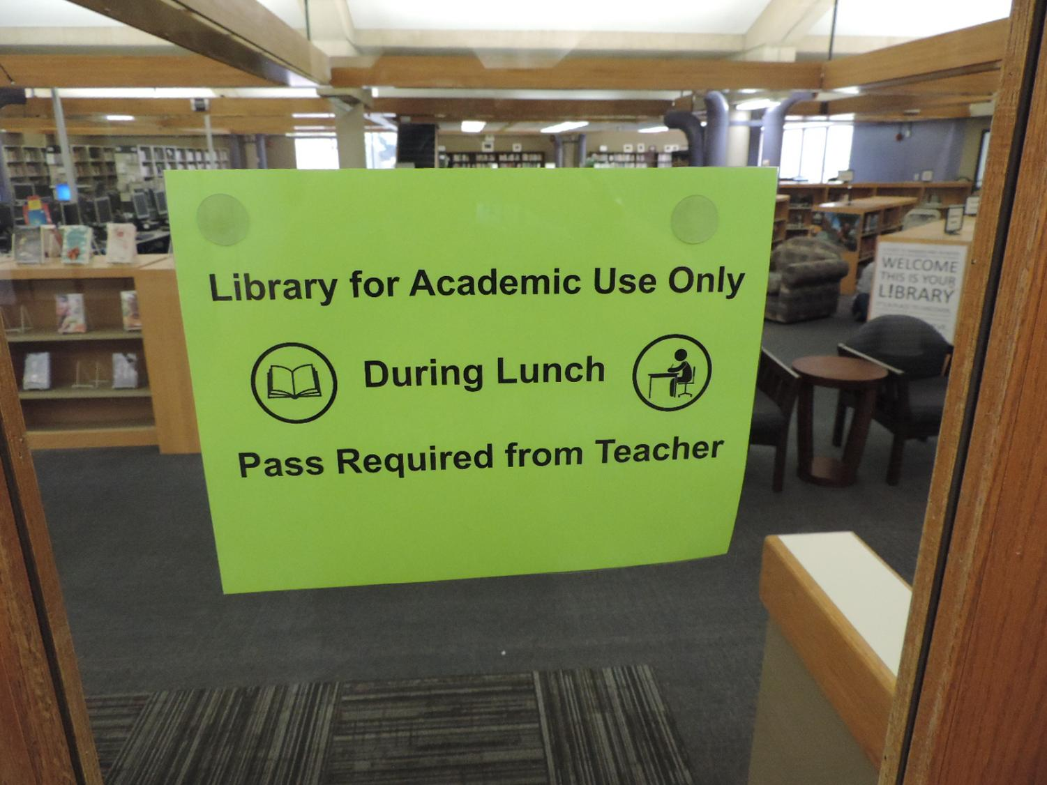 This sign located on the library doors sends a confusing message to students regarding their access to library resources. Students are able to use the library during lunch for academic purposes.