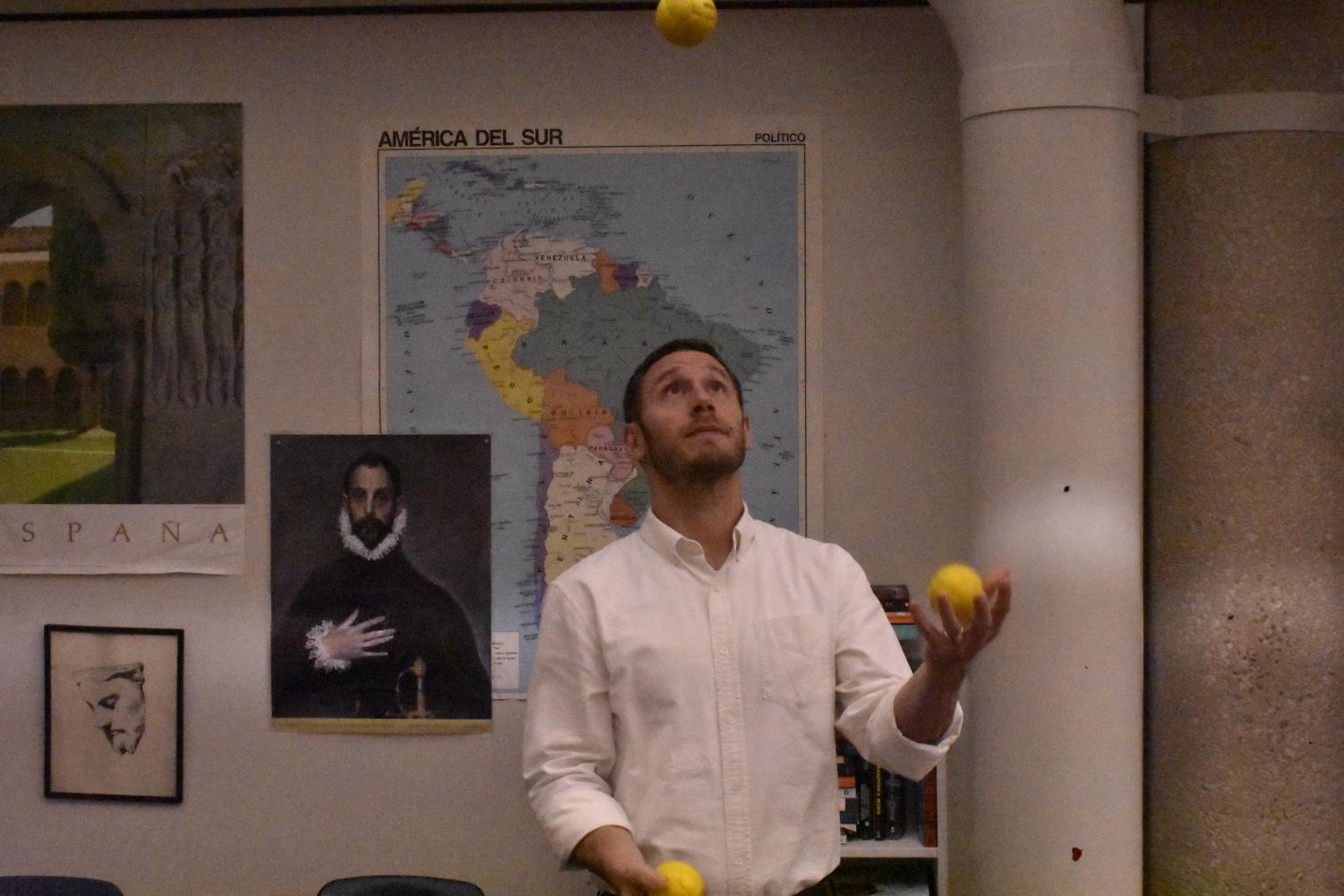 Latin and English teacher Adam Stiller juggles yellow tennis balls in his classroom. The juggling club meets every Tuesday in room 1500.
