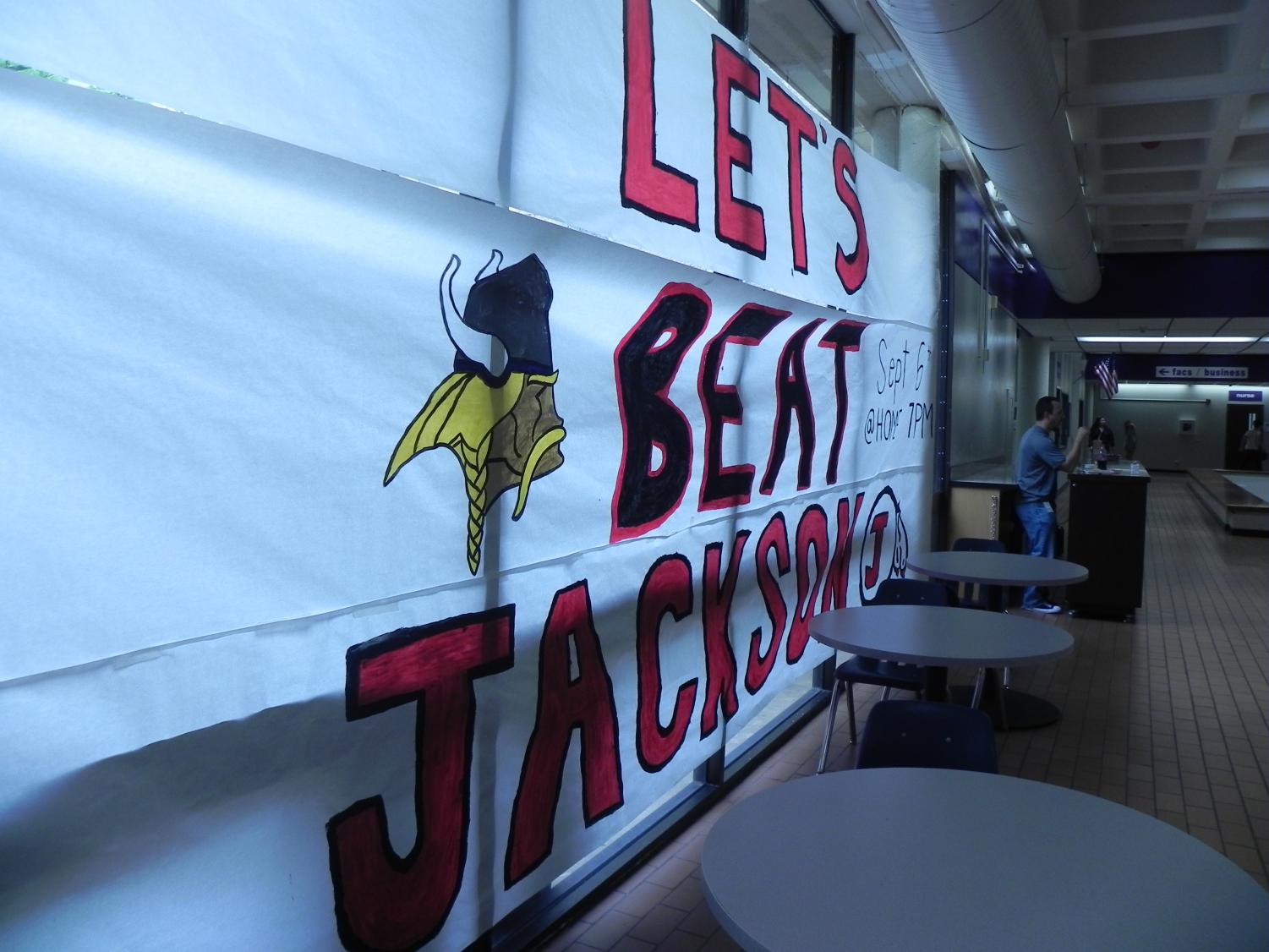 Parkway cheerleaders paint big posters to hype up the students during the week before the game. Sept. 6, North Vikings will be playing Jackson High School.