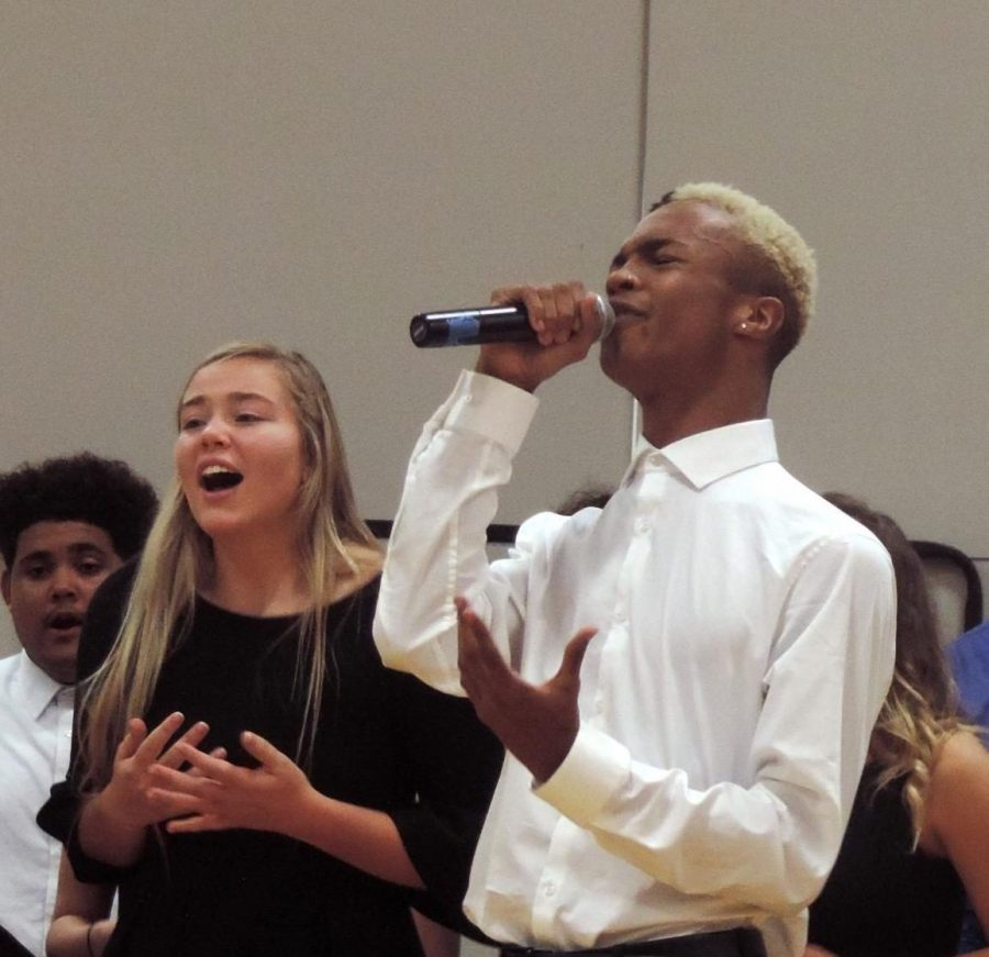 Senior+Jaylon+Gunn+sings+his+own+solo+with+the+North+Choir%E2%80%99s+Valholla+at+the+North+Choir+Fall+Concert+on+Oct.10.+He+and+the+Valholla+sang+If+I+Ever+Fall+in+Love+as+their+individual+concert+piece.