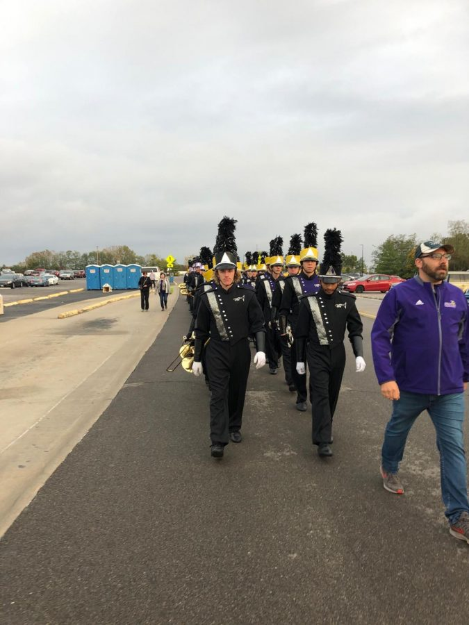 Students+of+the+PNH+band+line+up+and+march+into+their+final+competition+of+the+year+with+drum+major+senior+Logan+Boatright+and+junior+drum+major+junior+Keith+Pennel.+We+beat+Rolla+that+we+never+have+beaten+before%2C%E2%80%9D+said+Boatright.