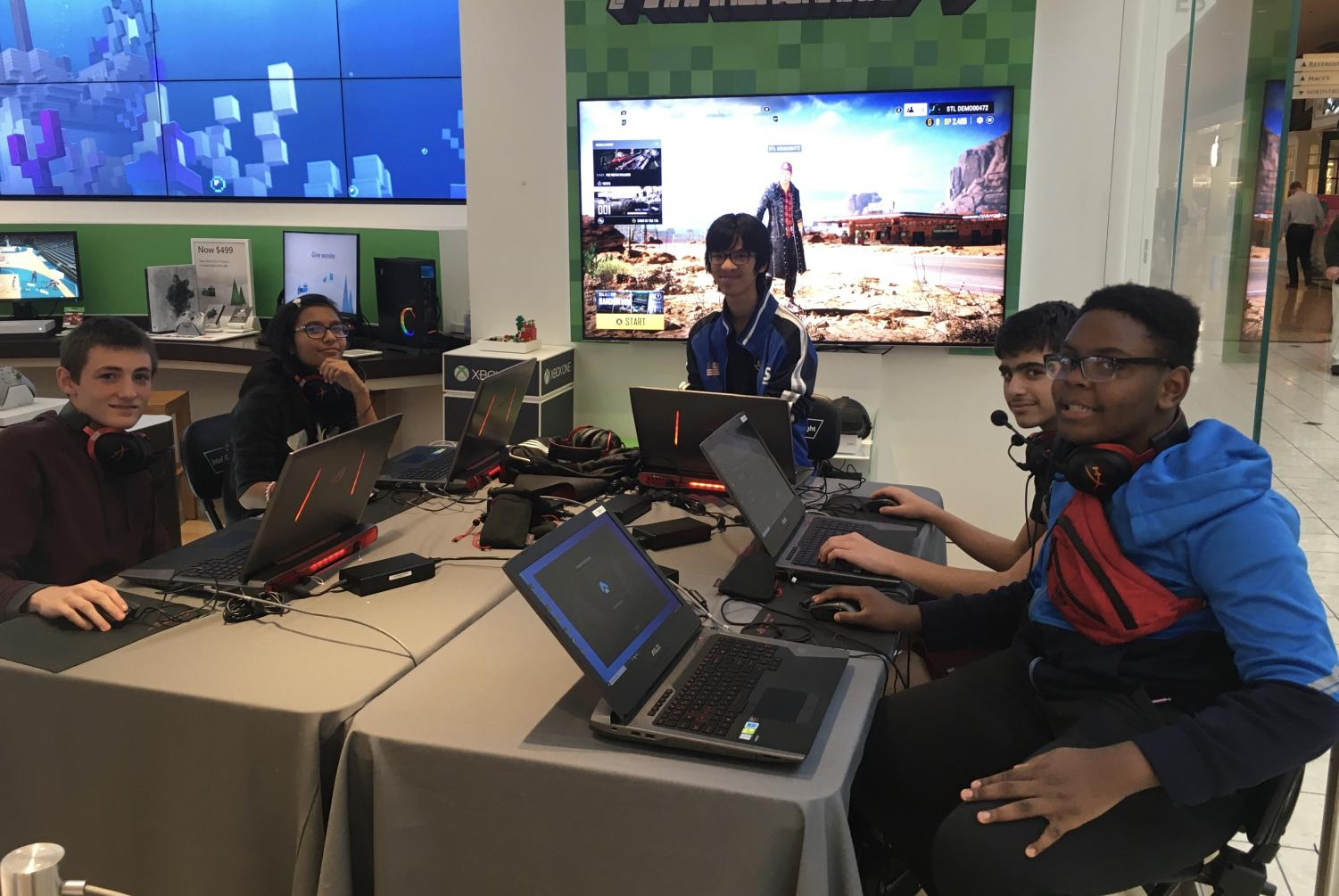 """Stemler,, Bucker, Birka, Aquino, and Henley compete in the Microsoft tournament. """"Playing as an entire team of 5 rather than soloq is a unique challenge, [but] I find it way more fun, and after your teammate makes a really good play, being able to walk up to them in real life and give them a high five makes all the difference,"""" said Buckner."""