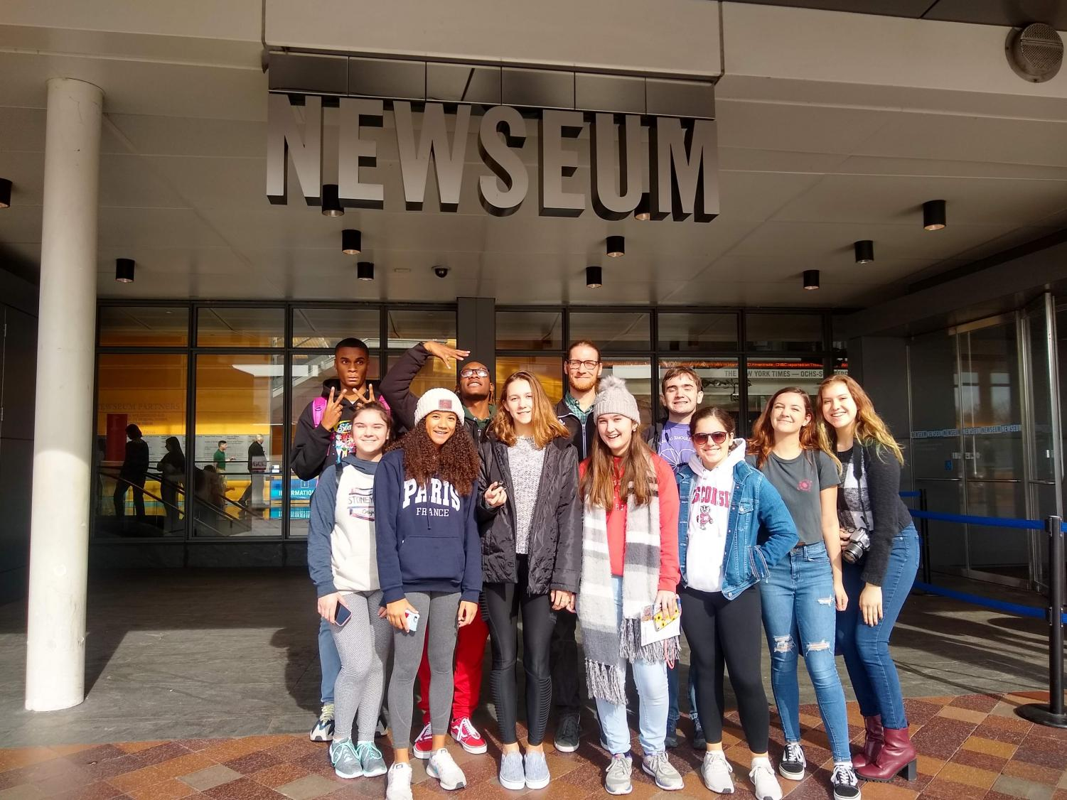 "Newspaper and yearbook staff smile in front of the Newseum after exploring the exhibits. ""I'm really glad I got to visit the Newseum before it closes this year. It's such a fun and interactive space, and I hope they find a way to reopen it in the future,"" said Fischer."