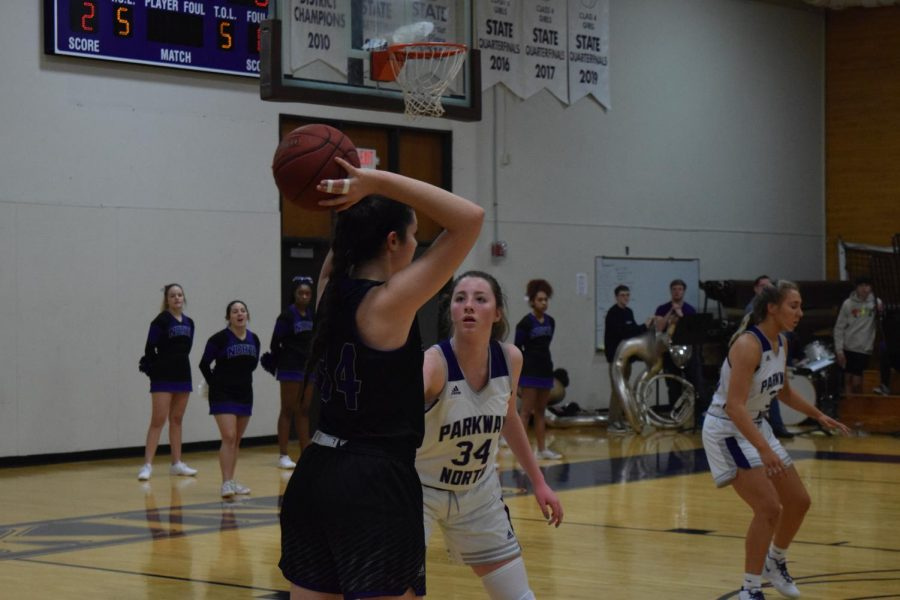 """Sophomore Madison Adolphsen guards a player from Fort Zumwalt West during Tuesday night's game, where they won 49-35. """"The best thing after winning is the feeling of knowing that we all worked and contributed so much together and it all paid off,"""" said Adolphsen."""