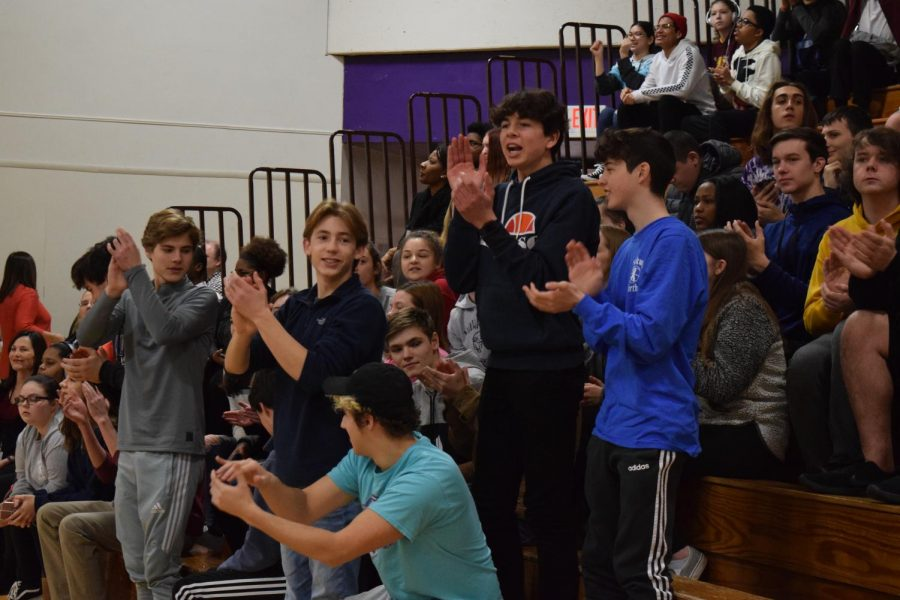 Students cheer for their classmates on the court after a basket was made halfway through the game. This shot sent the students ahead of the teachers by one point 14-13, though shortly after this the teachers made a comeback.