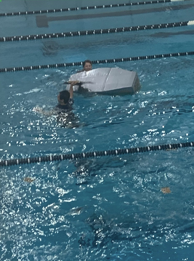 The+Cardboard+Boat+Challenge+was+to+make+a+boat+using+only+cardboard+and+duct+tape.+Whichever+team%E2%80%99s+boat+completes+one+lap+around+the+swimming+pool+the+fastest+wins+the+challenge.