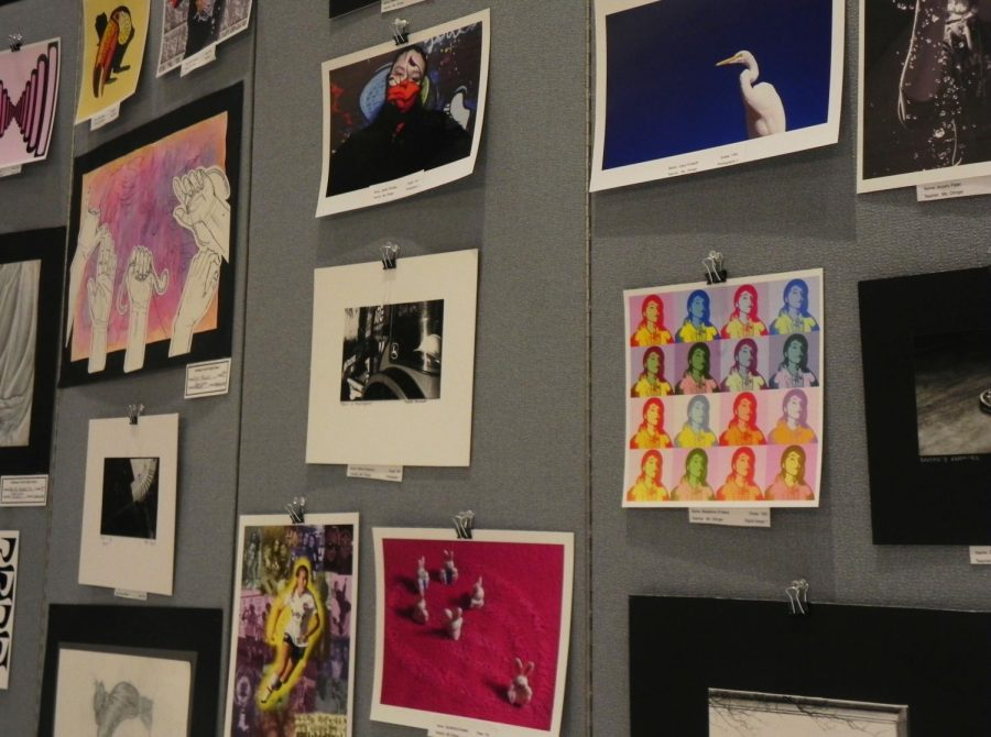 A+bulletin+board+showcases+different+artwork+from+North%E2%80%99s+students+ranging+from+classes+such+as+Drawing+1+to+Photography+1.+These+pieces+were+specifically+showcased+at+the+Annual+North+Regional+Art+Show.