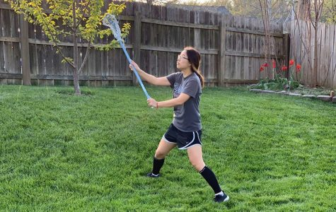 """Junior Cherry Qiu practices her stick skills for lacrosse during quarantine. """"It's hard to practice by myself because I don't have anyone to throw and catch with. I'm also trying to run during the week, but it's honestly hard to find motivation sometimes."""""""