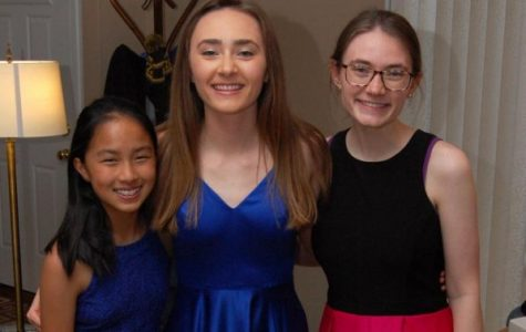 """Senior Hannah Schaff and her family enjoy a virtual prom hosted by John Krasinski on April 17. John Kransinski hosted a nationwide prom on his """"Some Good News"""" show to allow seniors to enjoy a night they would miss."""