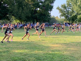 The girls cross country team takes off at McNair Park. North only raced against two teams, MICDS and John Burroughs, in order to keep a safe distance between the runners.