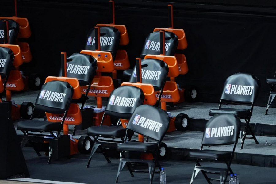 The Milwaukee Bucks bench remains empty after the scheduled start of game five against the Orlando Magic in the first round of the 2020 NBA Playoffs on August 26, 2020 at AdventHealth Arena at ESPN Wide World Of Sports Complex in Lake Buena Vista, Florida. The Bucks boycotted their game 5 playoff game against the Orlando Magic to protest the shooting of Jacob Blake by Kenosha, Wisconsin police. (Ashley Landis/Pool/Getty Images/TNS)