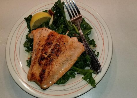 Food Network's Pan Seared Salmon with Kale and Apple Salad is an easy, accessible recipe for those that are trying to eat healthy and cheap.