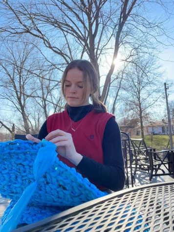Natalie Arnold crochets used plastic bags together to make one of the many mats she plans to donate to help people the homeless.